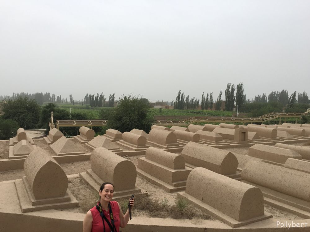 Sylvia in front of the unmarked graves @Emin Minaret