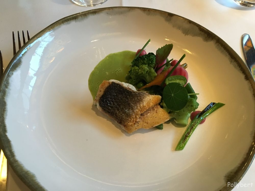 Baked sea bass caught with the line, mix of green vegetables, chive sauce with sage @Partick Devos
